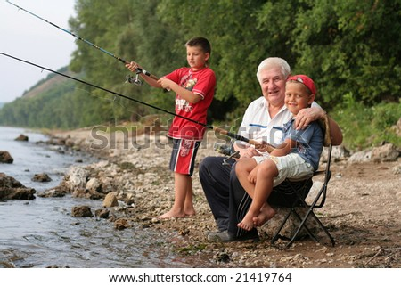 A grey-headed grandfather with a two grandsons on fishing