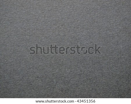 A grey or black cardboard useful as a background