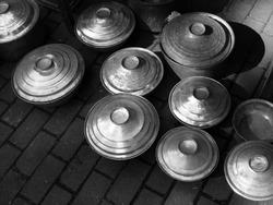 A greyscale shot of handmade kitchen utensils on the ground in Alacati, Izmir, Turkey