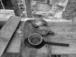 A greyscale shot of the handmade wooden kitchenware in Alacati, Izmir, Turkey