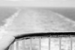 A greyscale shot of the railing on a sailboat