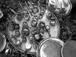 A greyscale shot of traditional Turkish jezve or cezve for making coffee in Alacati, Izmir, Turkey