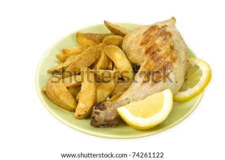 a grilled chicken leg with spicy country potatoes