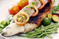 A grilled milk fish garnish with vegetables