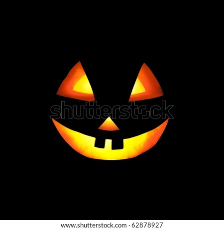 A Grinning Jack O Lantern Against a Dark Background