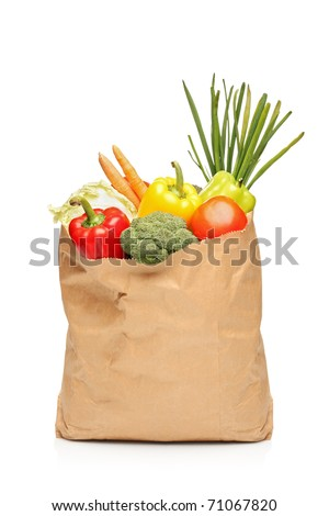 A grocery bag full with fresh vegetables isolated on white background