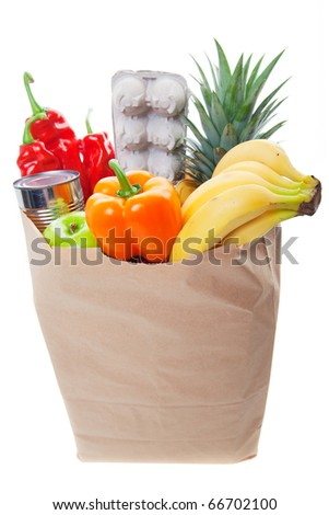 A grocery bag with eggs and healthy fruits and vegetables, Main Focus on front of bag