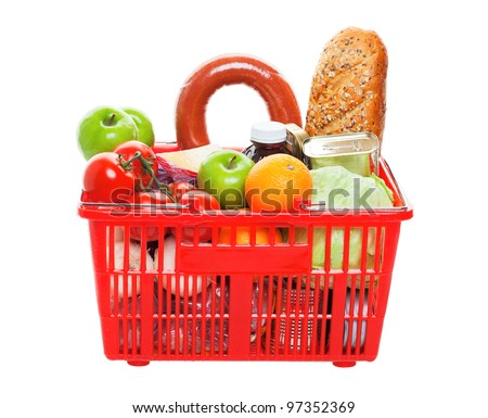 A grocery basket filled with fresh fruits, vegetables, sausage, bread, and canned goods.  Shot on white background.