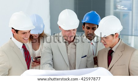 A group of architect discussing a construction plan in a building