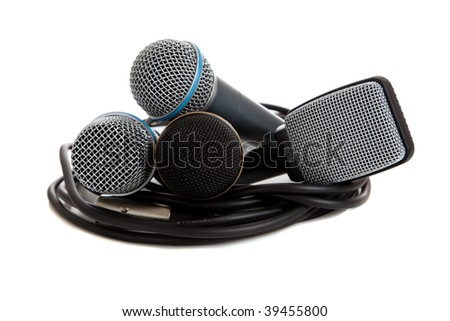 a group of Assorted Microphones on white with cord - stage equipment - communications theme, includes a guitar mic