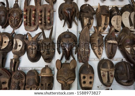 A group of beautiful traditional Ivory Coast masks. Masks are a prevalent art form in Ivory Coast they can symbolize lesser deities, the souls of the deceased, and even caricatures of animals.