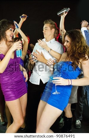 A group of beautiful young woman enjoying cocktails at party