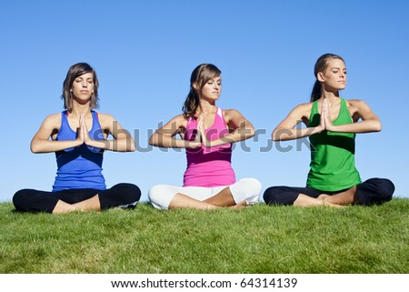 A group of beautiful young women doing yoga together - stock photo
