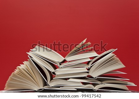 A group of books on red background