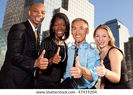 a group of business people giving a thumbs up sign