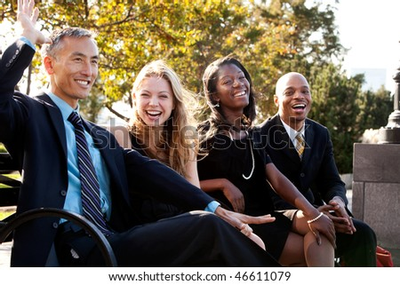 A group of business people having fun and joking - stock photo