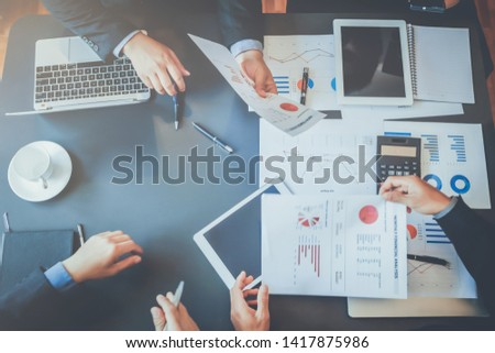 A group of business people in the meeting room are introducing and consulting each other in order to make good business profits. Concepts for advice and consultation between business groups