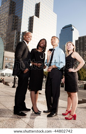 A group of business people looking out of the frame - future concept