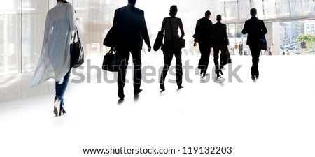 A group of business people on a light background. Silhouettes. Urban scene.