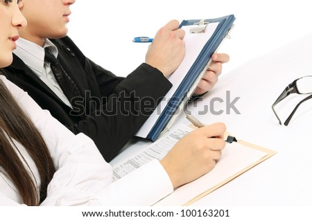 A group of business people working together on white background - stock photo