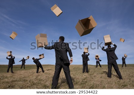 a group of businessman in the field with cardboard boxes (some motion blur on fast movement)