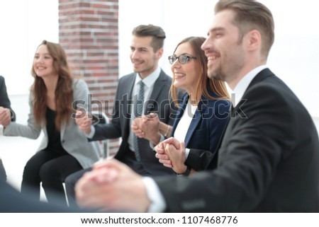 A group of businessmen holding hands in a circle
