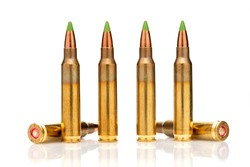 A group of 5.56 calibar, green tip bullets on white background