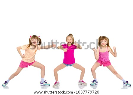 A group of cheerful, emotional children keep their thumbs up. The concept of advertising, sports and fitness. Isolated on white background.