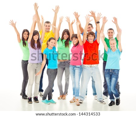 A group of cheerful people posing with their arms up.