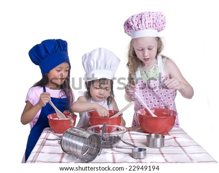 A group of children cooking up something in the kitchen. Isolated on white