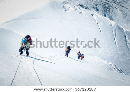 A group of climbers reaching the summit #367120109