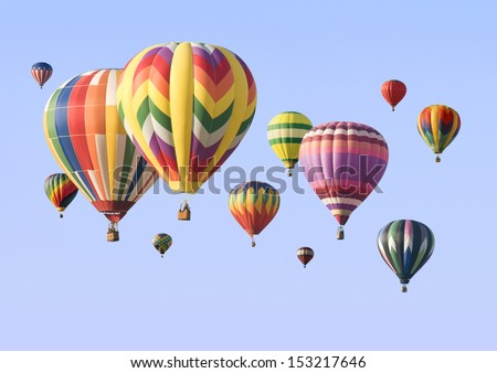 A group of colorful hot-air balloons floating across the sky