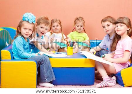 A group of cute preschool children enjoying their art and craft activities