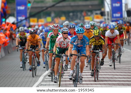 A group of cyclist racer racing - stock photo