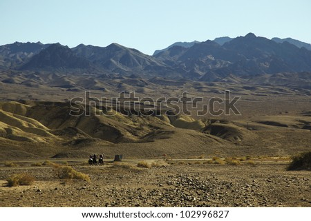 A group of cyclists cycle along the hot and scenic death valley national park, California