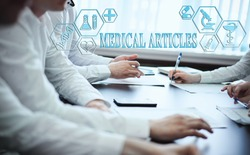 A group of doctors in a modern clinic is planned. The concept of modern medicine and medical biotenology. Medical icons on the screen with the inscription: MEDICAL ARTICLES