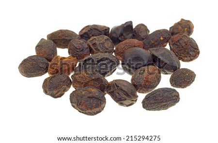 A group of dried saw palmetto berries on a white background.
