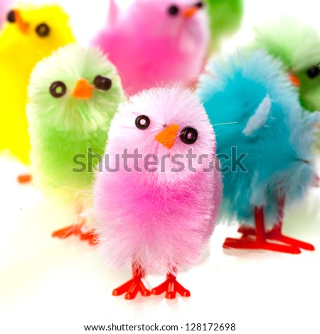 a group of easter chickens in four colors