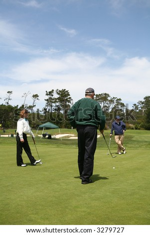 A group of elderly golfers on the golf course