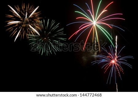 A group of fireworks exploding in night sky to celebrate Independence day in USA or July 4th holiday