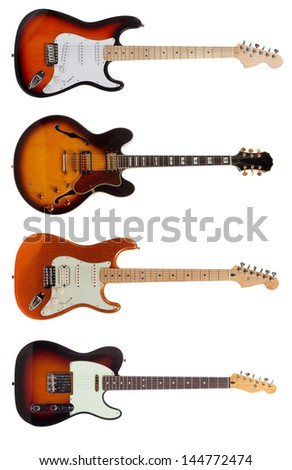 A group of five electric guitars on a white background