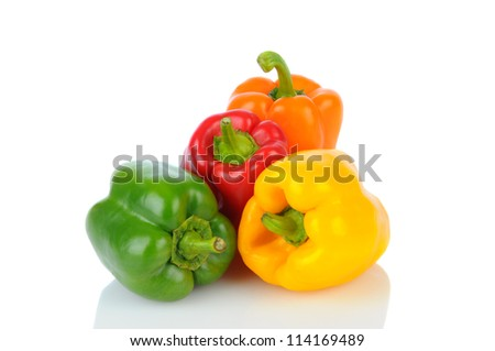 A group of four bell peppers on white with reflection. Green, Yellow, Red and Orange peppers in horizontal format.