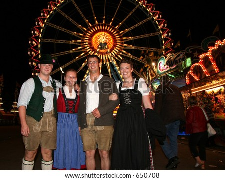 A group of four German Oktoberfest fans in Traditional costume