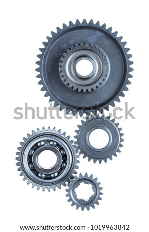 A group of four large steel gears are connected together over a plain white background. #1019963842
