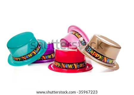 A group of four New Years eve decorative or costume hats on a white background