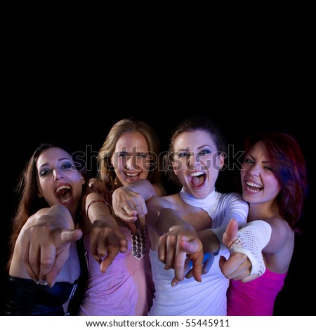 A group of four young fresh women partying. Nice lively image.