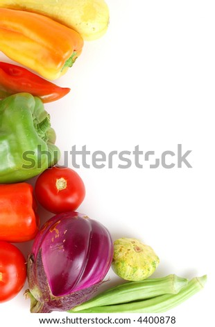 A group of fresh picked vegetables and fruit from a late summer or early autumn harvest.