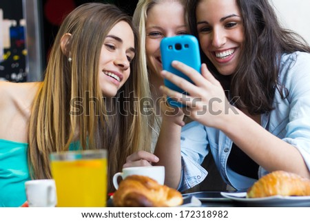 A group of friends having fun with smartphones #172318982
