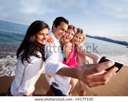 A group of friends taking a self portrait with a camera phone