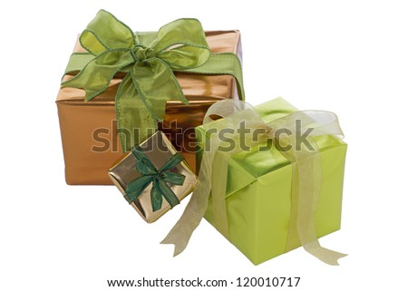 A group of gift boxes wrapped in shiny gold and green paper and tied with gold or green organza and taffeta ribbon